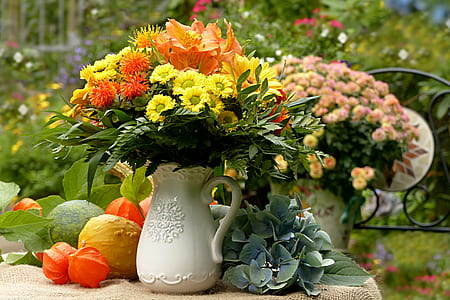 orange lilies and yellow mums centerpiece