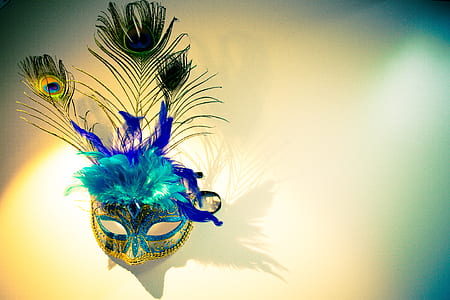 blue and green peacock feather design mask