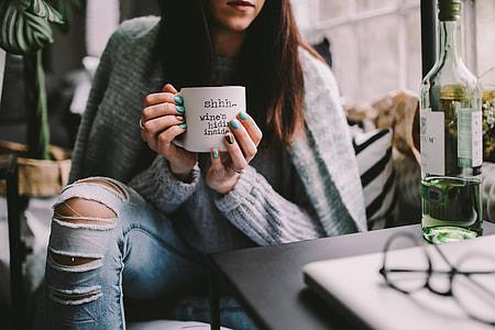 Girl drinking wine in her mug