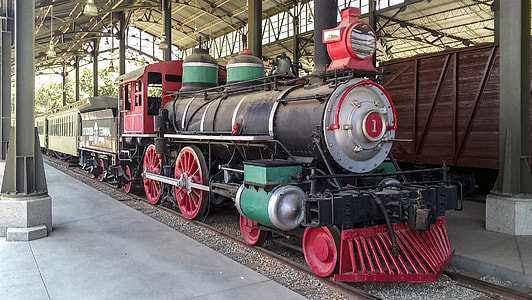 black and red locomotive train