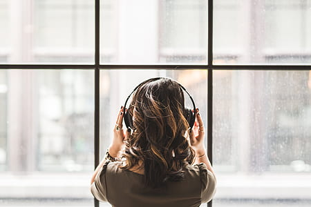 woman in the window while listening music