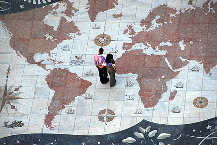 man and woman standing on white and brown map painted floor