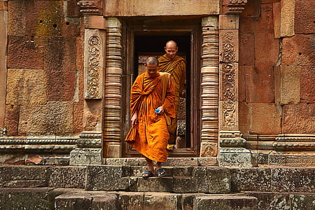 Two Monk in Orange Robe Walking Down the Concrete Stairs