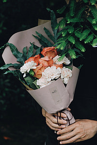 white and brown carnations and roses boququet