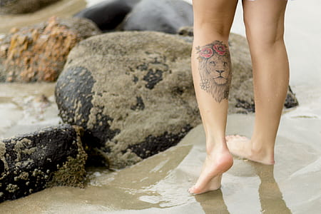 Person With Lion Tattoo