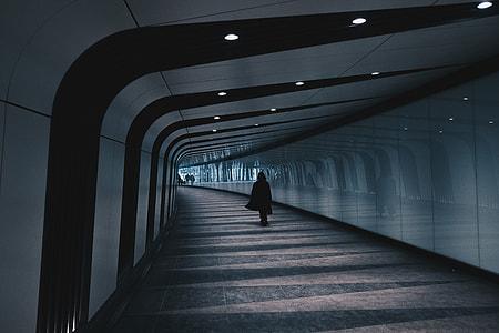 Person walking in modern city tunnel