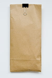 beige paper pack with white background
