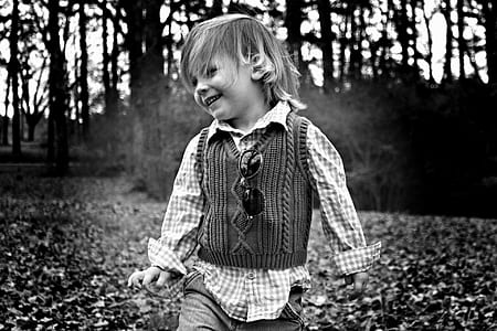 grayscale photography of child playing