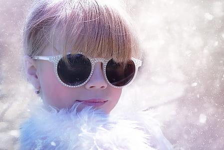 close up photo of girl wearing sunglasses