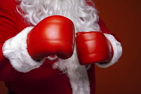 Santa Claus wearing red boxing gloves