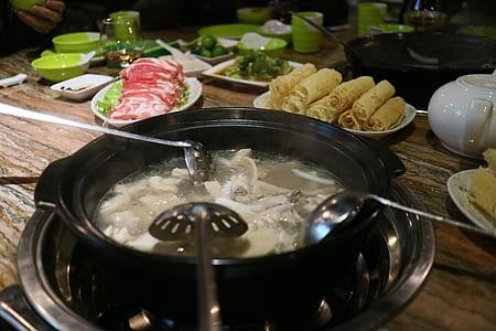 Food With Broth on Black Pot