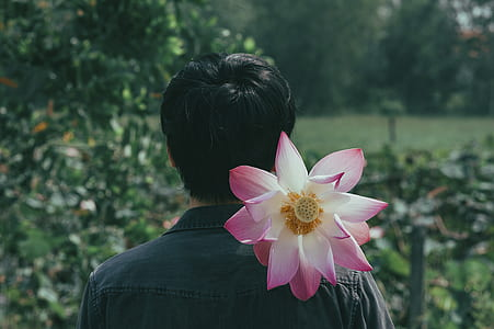 Pink Flowers on the Shoulder of Person
