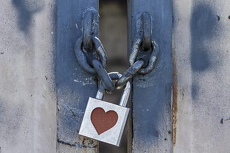 close-up photo of heart-printed padlock