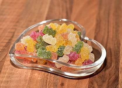 gummy bear candies in glass heart bowl