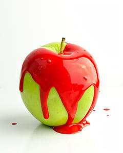 granny smith apple with red paint