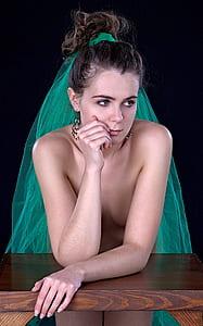 woman wearing green veil