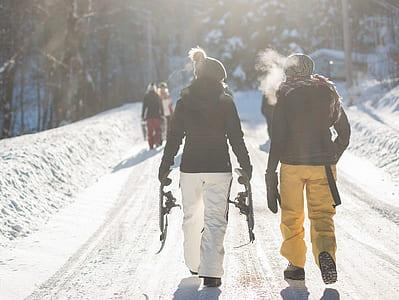woman wearing black coat beside man during daytime