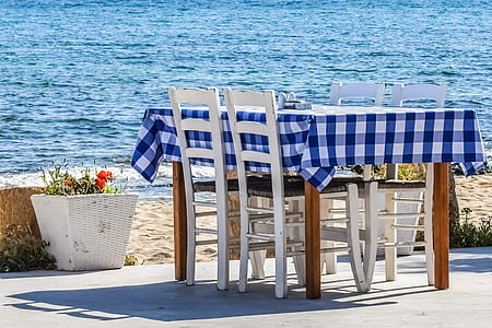 blue and white plaid table cloth on brown wooden table