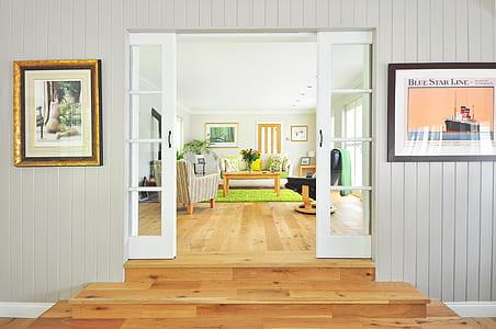 white wooden door to living room furniture set