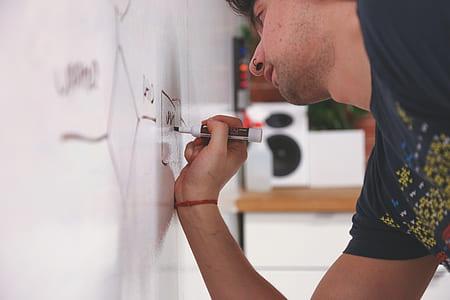 man holding marker