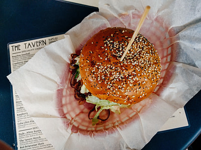 burger with stick on white tissue paper