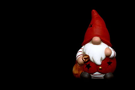 dwarf figurine on black surface