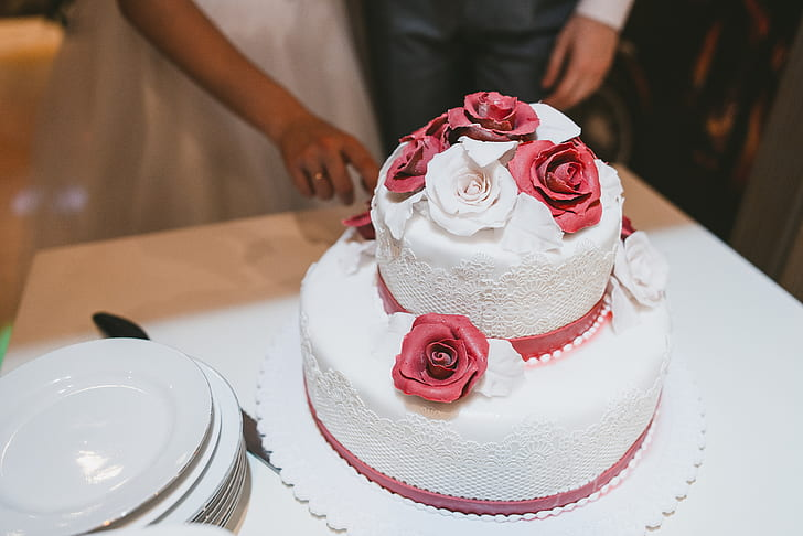 closeup photo of 2-tier cake with flower accent