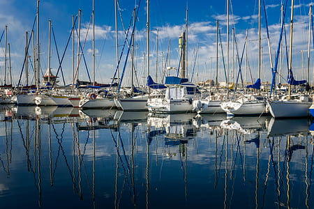 white sailing boats on water