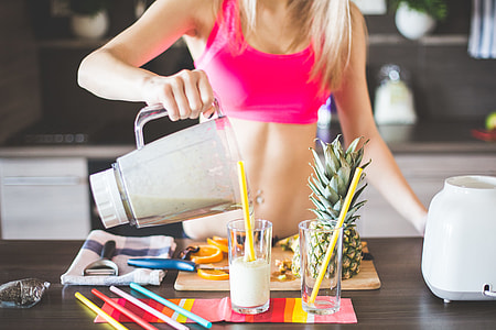 Fitness Girl Preparing Healthy Smoothie