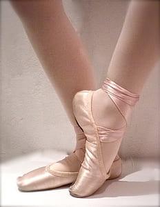 woman wearing pink ballet shoes