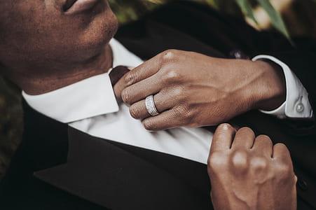 men wearing white and black coat & tie