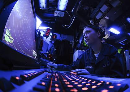 woman operating radar monitoring system