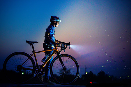 Man out with bicycle at night