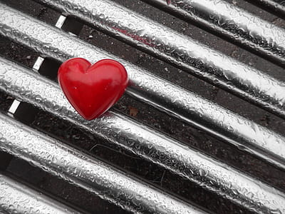 red heart on gray metal board