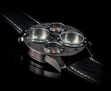 photo of black and silver analog watch