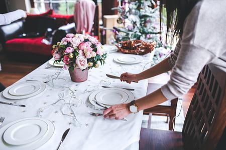 woman doing table setup