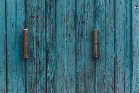 teal wooden door with hitch