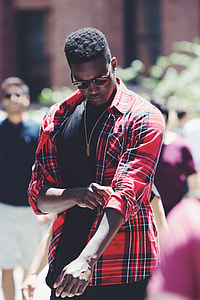 man in black, red, and white plaid sports shirt