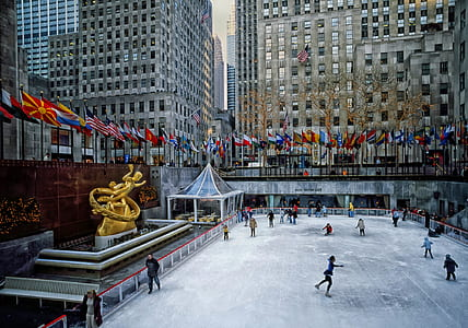 group of people doing ice skating during daytime