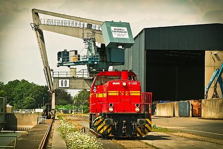 Red Mak Train on Brown Train Tracks