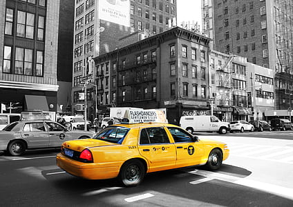 yellow taxi on road