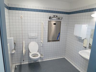 white ceramic toilet sink inside bathroom