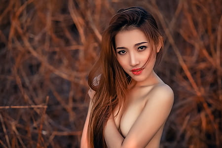 selective focus photo of topless woman