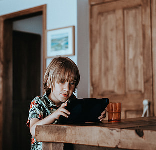 Child playing on iPad