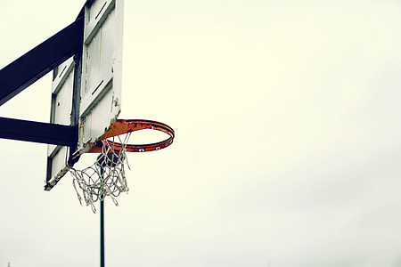 white and black basketball hoop during cloudy day