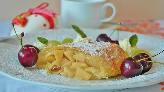 pastry in between of cherries filled with sugar served on plate