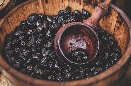 brown wooden bucket with prune fruits \