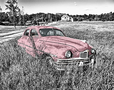vintage red car on grassland