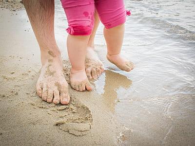 toddler walking on seashore