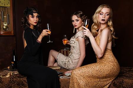 three women drinking